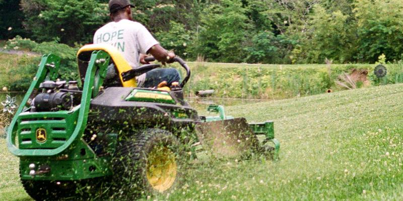 Mowing lawn on riding lawn mower